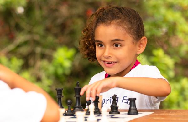Kids playing chess.