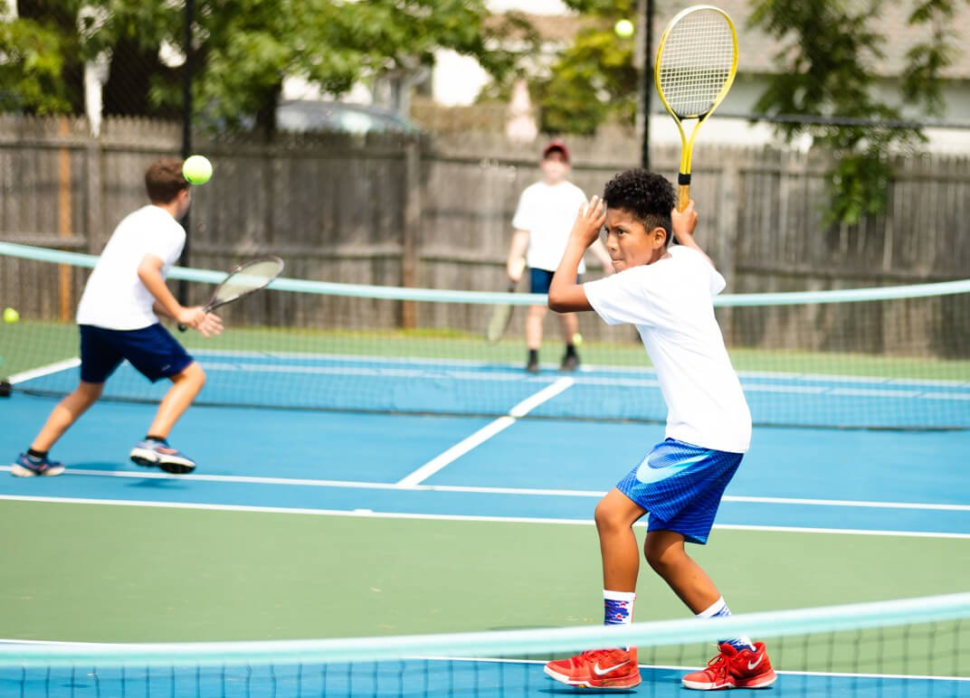 Young athlete playing tennis.