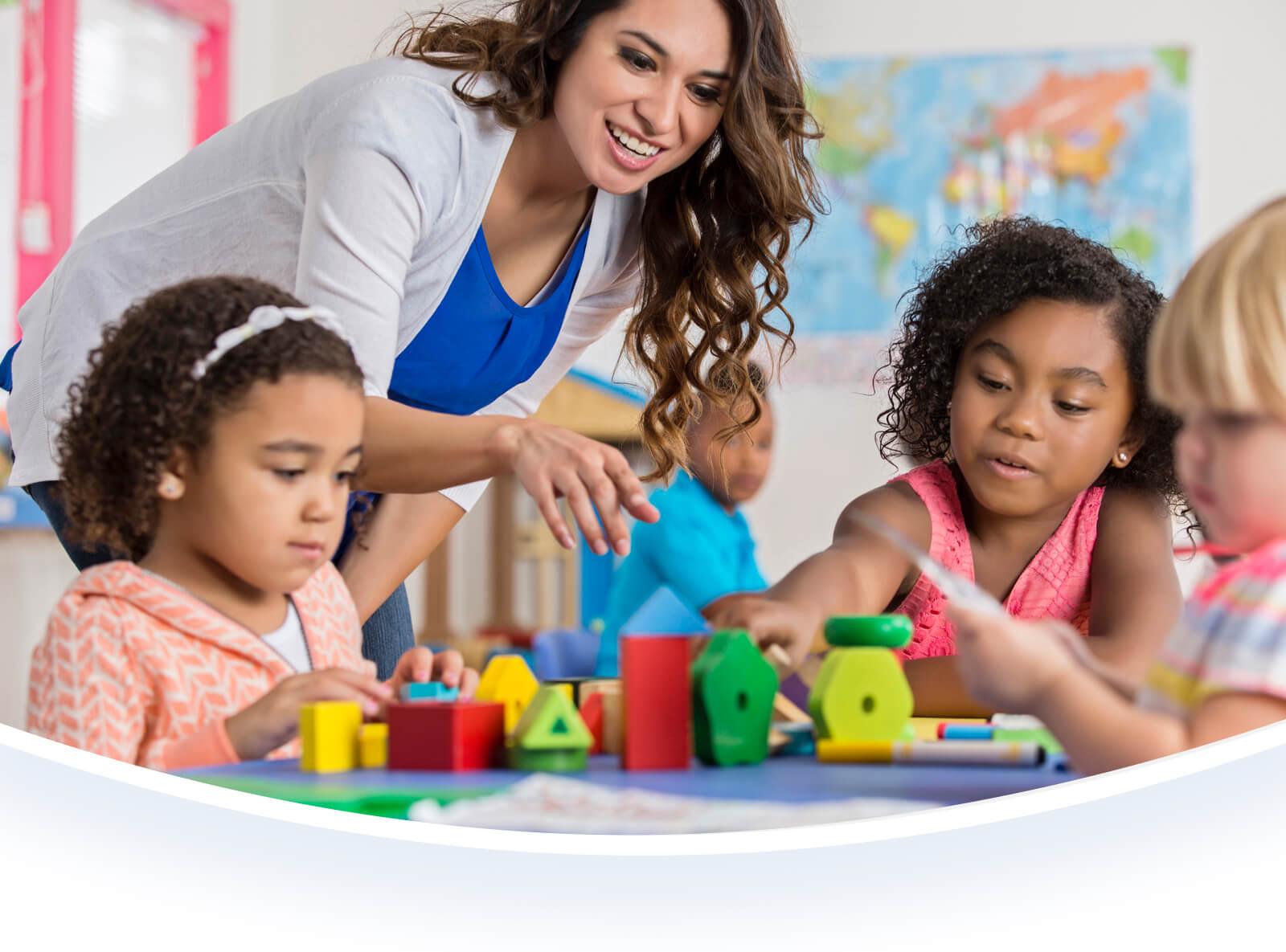 Female teacher helping students